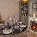 2-classical-style-gray-dining-room-interior-design-Christmas-table-setting-Luminarc-tableware-Almin-cutlery-designer-wreath-tree-book-shelves-fireplace