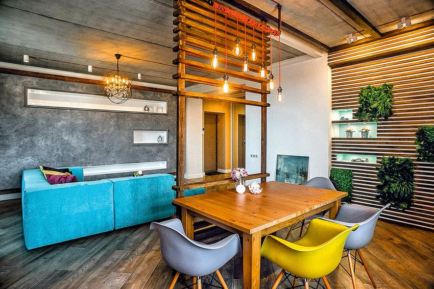 2-mixed-style-brutal-loft-pop-art-eco-style-apartment-interior-design-ceiling-faux-concrete-walls-open-wiring-wooden-planks-open-plan-living-room-kitchen-dining-room-bright-blue-velvet-sofa-mismatched-chair-wall-decor