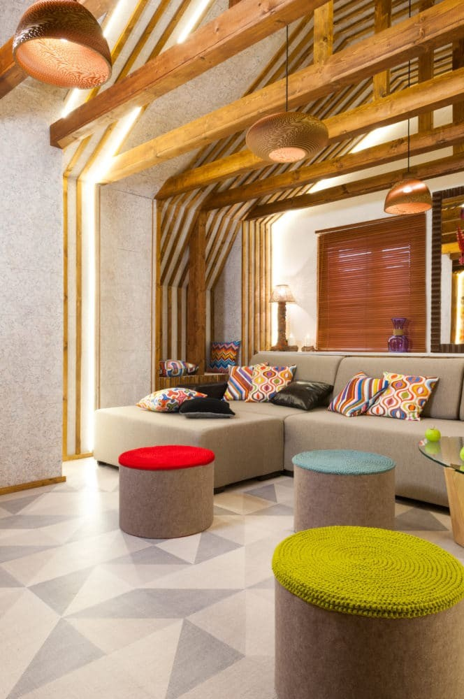 3-bright-colorful-attic-floor-interior-design-living-room-corkwood-floor-wall-wooden-planks-wall-decor-recessed-lighting-LED-bands-ottomans