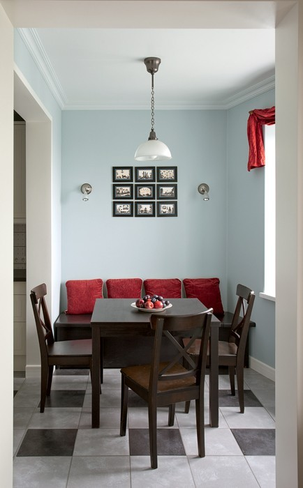 3-small-dining-room-design-light-blue-walls-red-accents-couch-pillow-chained-cileing-lamp-dark-wood-table-chairs-set