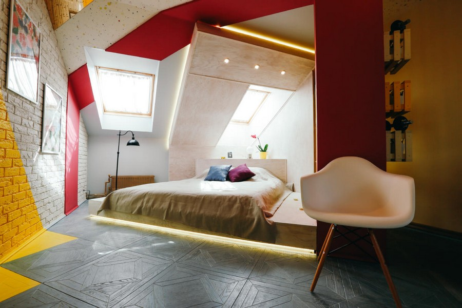 3-ultra-bright-attic-interior-design-diagonal-funriture-arrangement-brick-tiles-gray-yellow-fuchsia-pink-accents-bed-on-podium-veneer-plywood-wall-ceiling-decor-plastic-chair
