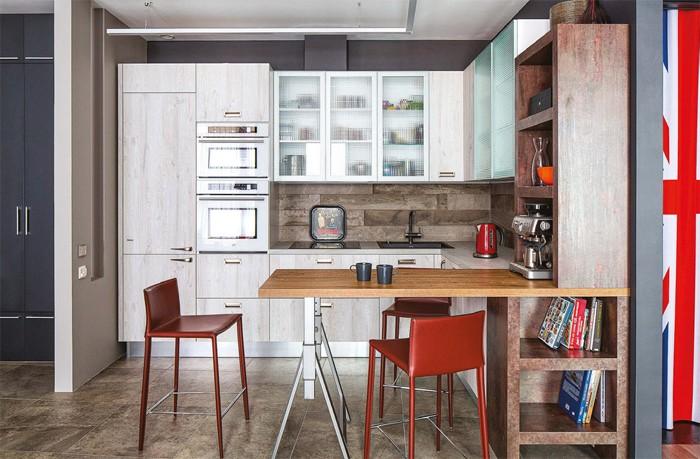 4-gray-loft-style-bachelor's-apartment-interior-design-open-plan-kitchen-built-in-fridge-freezer-whitewashed-faux-wood-recessed-flush-pull-handles-retro