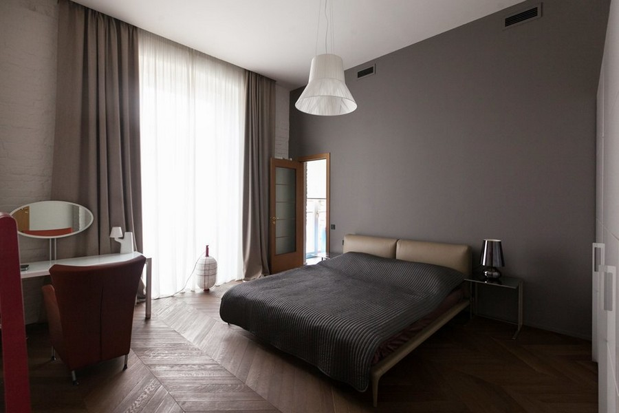 4-minimalist-style-interior-design-apartment-gray-walls-bedroom-orange-wheeled-arm-chair-beige-headboard-lamp