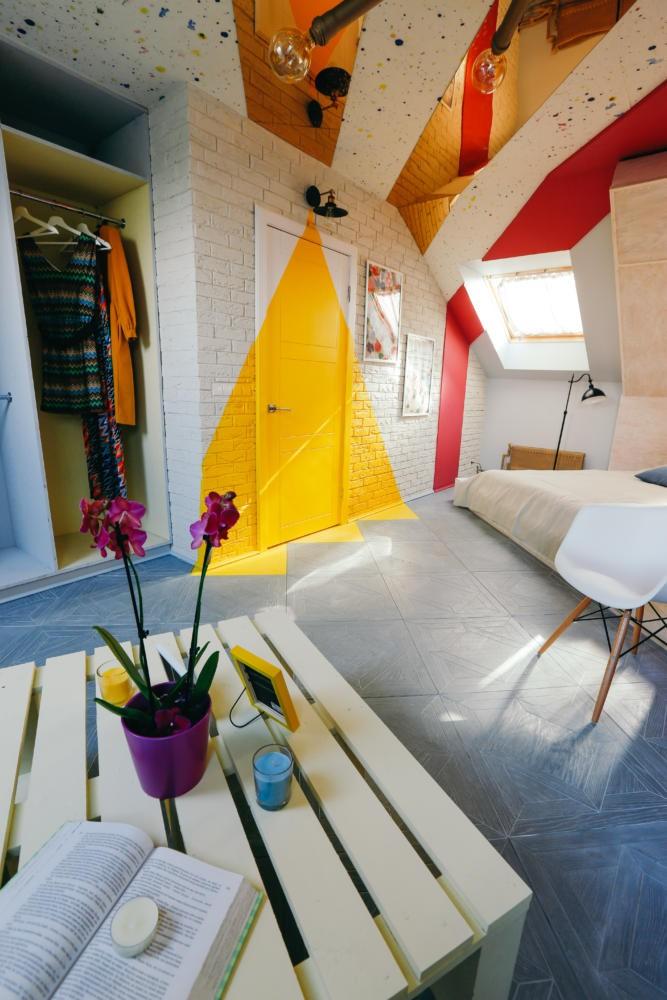 Bright Attic Interior Design with Diagonal Furniture ...