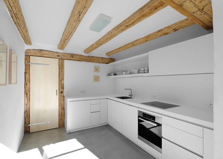 5-France-chalet-interior-design-Scandinavian-style-rough-wooden-beams-white-walls-modern-kitchen-set-minimalist-panoramic-windows-winter-view