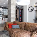 5-gray-loft-style-bachelor's-apartment-interior-design-open-plan-living-room-kitchen-aged-brown-soft-leather-sofa-work-area-load-bearing-column