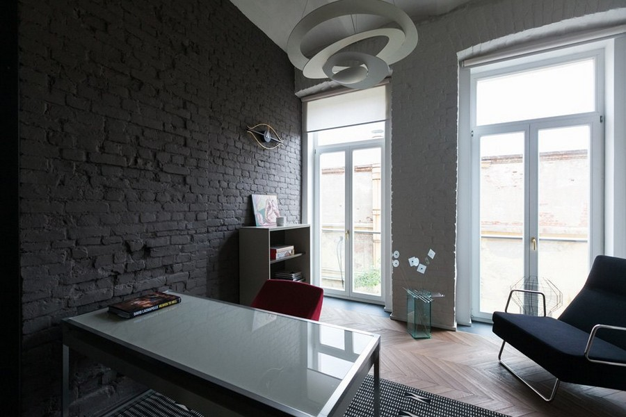 5-minimalist-style-interior-design-apartment-old-gray-brick-wall-black-contemporary-arm-chair