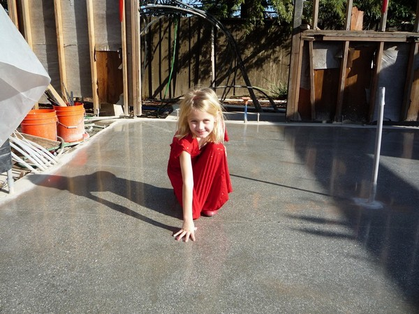 6-girl-sitting-on-polished-concrete-floor