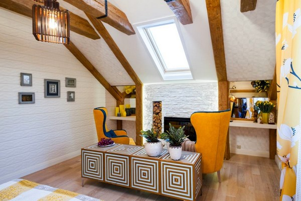 7-cheerful-blue-yellow-white-attic-bedroom-interior-design-ceiling-beams-3D-walls-artificial-stone-fireplace-surround-skylight