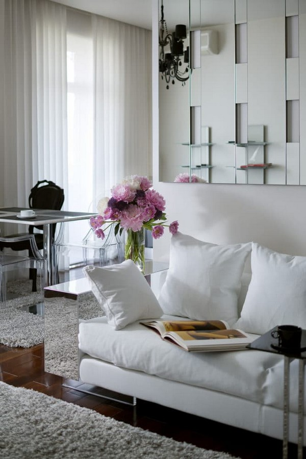 8-cozy-elegant-neo-classical-modern-black-and-white-interior-design-open-concept-living-room-black-crystal-chandelier-Kartell-white-sofa-with-mirrored-arm-rest-Flexform-mirror-wall