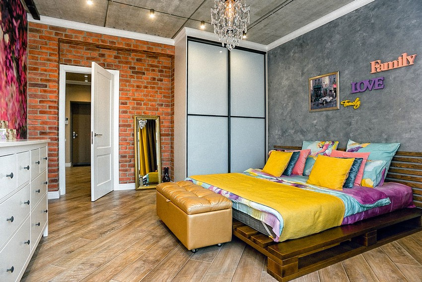 8-mixed-style-brutal-loft-pop-art-eco-style-apartment-bedroom-interior-design-concrete-ceiling-faux-concrete-brick-walls-open-wiring-crystal-chandelier-palette-bed-bright