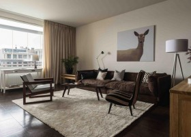 1-contemporary-Scandinavian-style-interior-design-gray-beige-black-white-brown-living-room-lounge-sofa-wood-corkwood-floor-with-digital-printing-arm-chair-hinged-lamp-animalistic-deer-painting-curtains-carpet