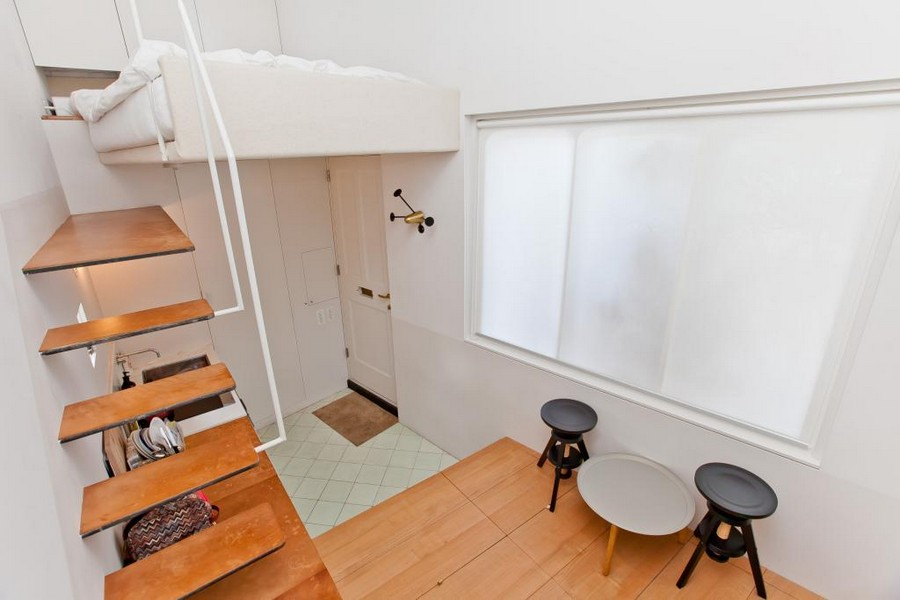 1-small-tiny-one-bed-bedroom-house-in-London-Islington-England-white-walls-loft-bed-entry-dining-room