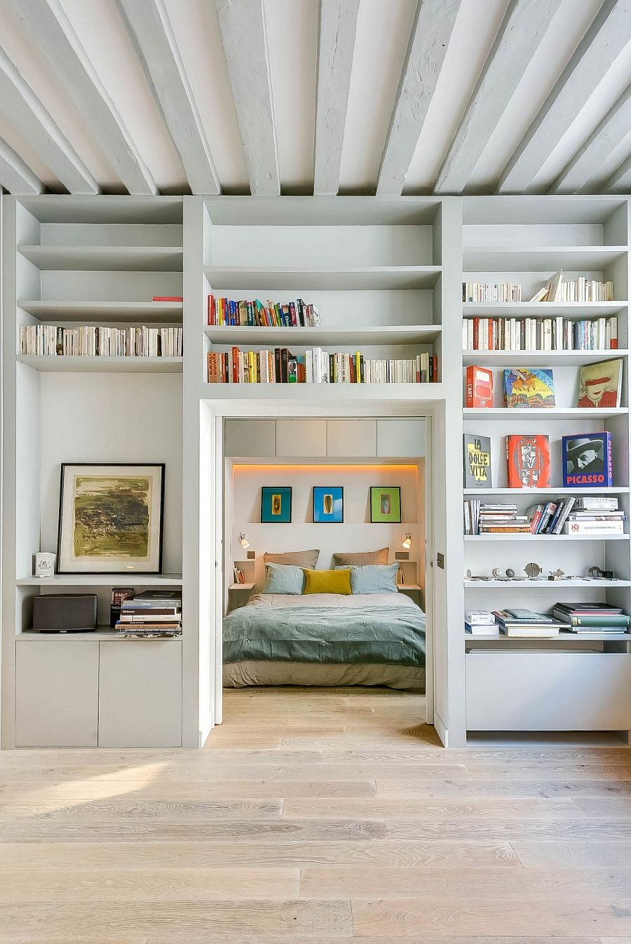 10-modern-French-apartment-interior-design-France-bedroom-books-wooden-floor-planks-ceiling-bed
