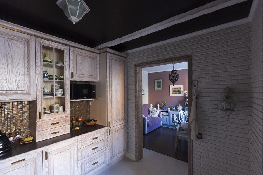 2-2-eclectic-provence-style-interior-design-white-kitchen-set-black-ceiling-wallpaper-faux-brick-wall
