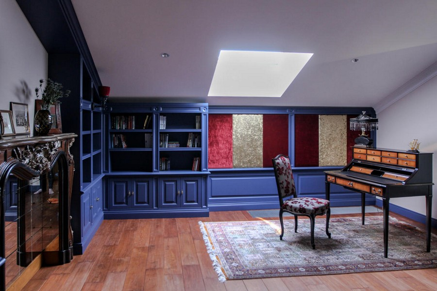 2-attic-floor-interior-design-eclectic-style-ethnical-motifs-big-home-library-dark-blue-book-shelves-skylight-Iranian-carpet-white-ceiling-faux-mirror-fireplace-classical-work-desk-bureau-chair