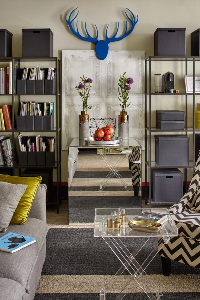 2-bright-cheerful-white-gray-and-green-office-interior-design-in-contemporary-style-horns-on-the-wall-storage-boxes-folders-shelves-coffe-table-sofa-mirrored-furniture-cabinet