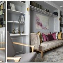 2-gray-pink-beige-French-style-living-room-home-library-interior-design-with-art-deco-elements-shelving-unit-sofa-arm-chairs-faux-fireplace-lamps