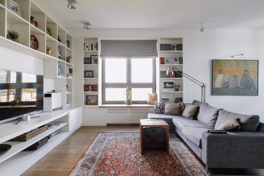 2-minimalist-style-white-walls-and-gray-apartment-interior-design-open-concept-living-room-big-shelving-unit-gray-corner-sofa-carpet-floor-lamp-roman-blinds-TV-set