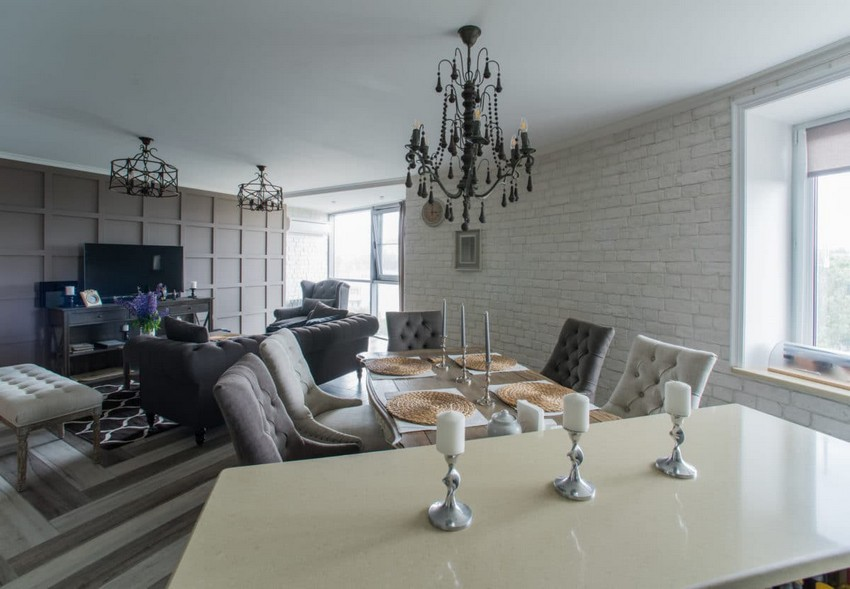 2-white-gray-brown-French-style-open-concept-living-dining-room-kitchen-interior-design-faux-brick-plaster-3D-chocolate-MDF-wall-chandelier-island-table-mismatched-chairs