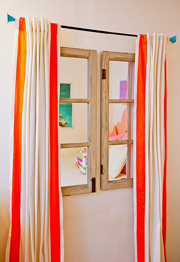 3-bright-white-walls-orange-yellow-accents-windowless-bedroom-room-interior-design-stripy-curtains-turquoise-finials-faux-window