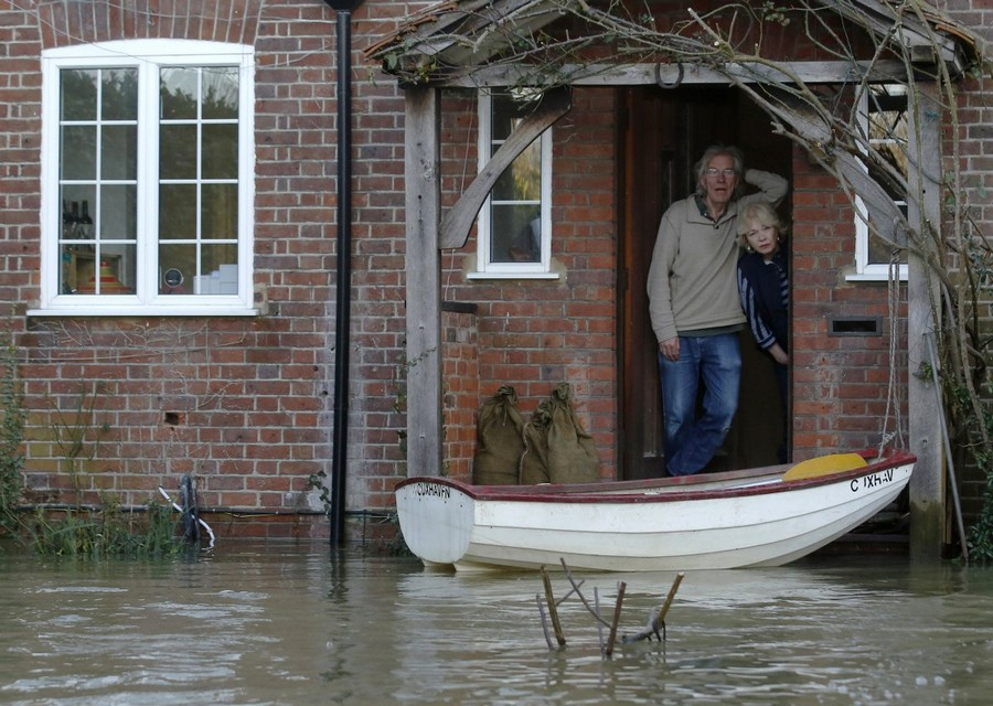 3-flood-flooded-house-people-on-porch-in-home