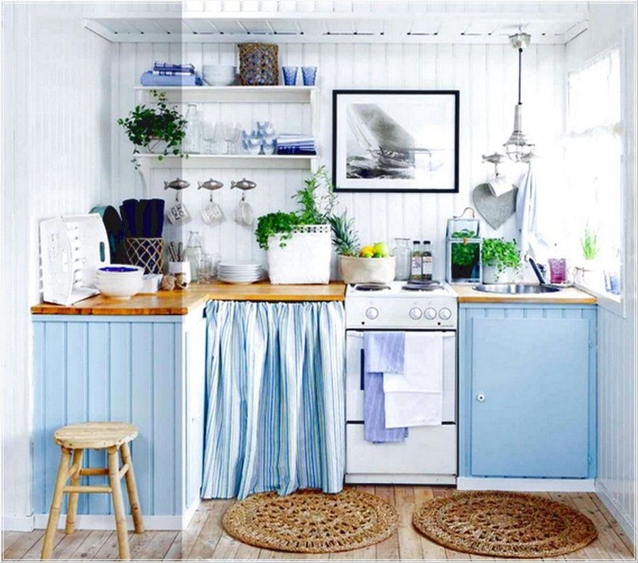 3-modern-French-apartment-interior-design-France-small-tiny-light-blue-and-white-kitchen-set-shelves-stove-cabinets-curtain