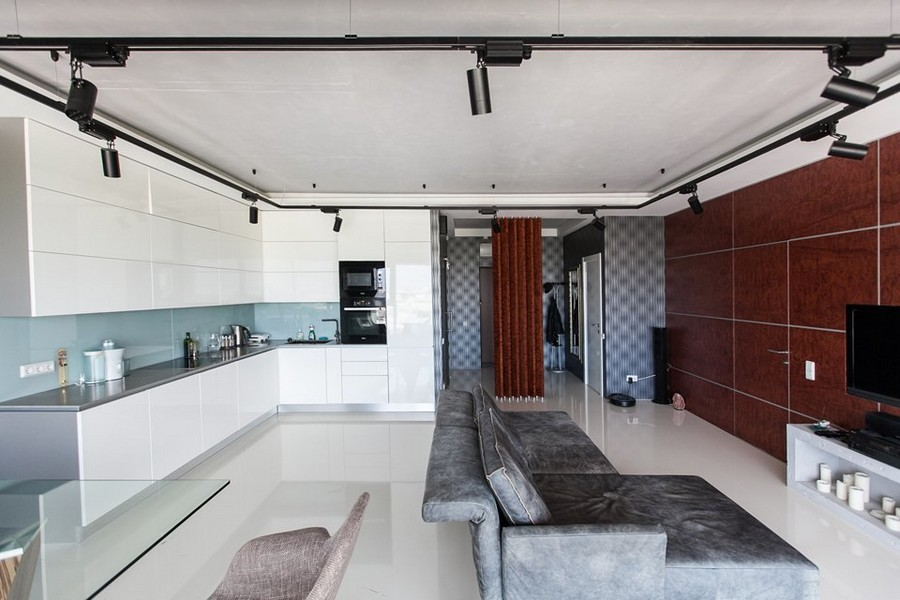 4-bachelor's-loft-style-apartment-open-concept-living-room-white-kicthen-interior-design-gray-concrete-ceiling-self-leveling-polymeric-floor-blue-wallpaper-red-bubinga-wood-wall-invisible-door-track-lights-glass