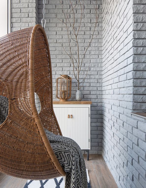 4-minimalist-style-balcony-interior-design-white-walls-clincker-bricks-suspended-wicker-arm-chair