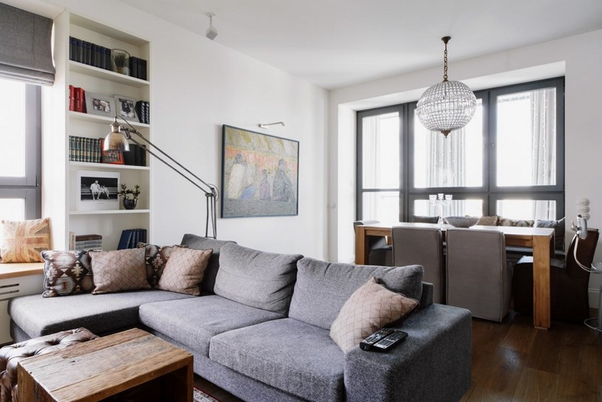 5-1-minimalist-style-white-walls-and-gray-apartment-interior-design-open-concept-living-dining-room-big-gray-corner-sofa-table-roman-blinds