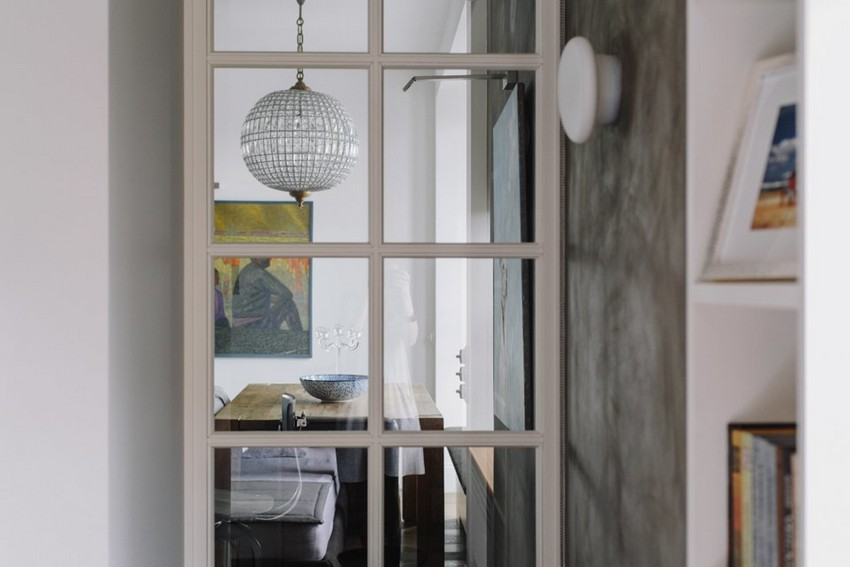 6-1-minimalist-style-white-walls-and-gray-apartment-interior-design-glass-partition-from-living-room-to-bedroom