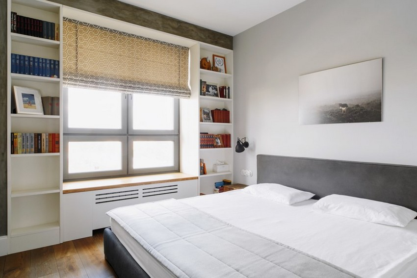 6-2-minimalist-style-white-walls-and-gray-apartment-interior-design-bedroom-shelving-unit-storage-around-the-window-roman-blinds-photo-above-headboard-bed