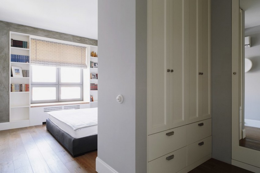 6-6-minimalist-style-white-walls-and-gray-apartment-interior-walk-in-closet-mirror-wardrobes-bedroom-roman-blinds-big-shelving-unit-around-the-window