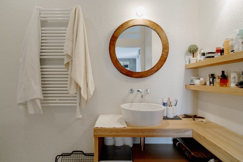 6-8-minimalist-style-white-walls-bathroom-apartment-interior-design-wooden-countertop-round-mirror-wooden-shelves