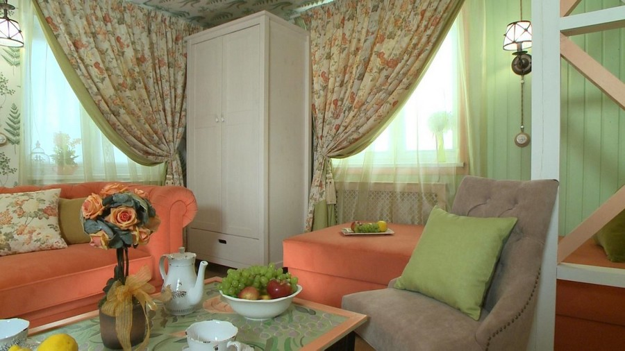 6-Provence-style-living-room-interior-design-green-mint-and-coral-colors-floral-curtains-drapery-sofa-coffee-table-setting-white-wardrobe