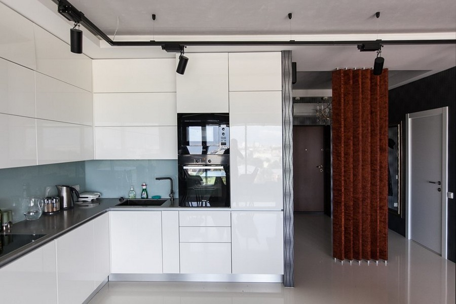 6-bachelor's-loft-style-open-concept-living-room-kitchen-entry-interior-design-gray-concrete-ceiling-self-leveling-polymeric-floor-blue-wallpaper-vertical-wooden-planks-partition-glass-backsplash-push-to-open-doors