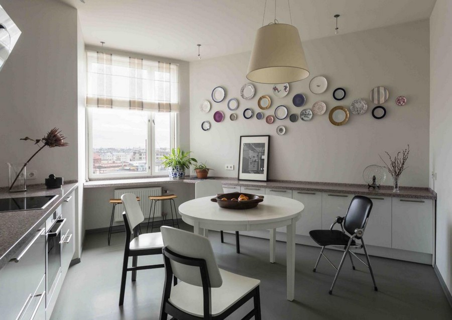 6-contemporary-Scandinavian-style-kitchen-interior-design-gray-beige-white-base-cabinets-stone-worktop-round-dining-table-chairs-folding-windowsill-decorative-wall-plates-traditional-pendant-lamp-roman-blinds
