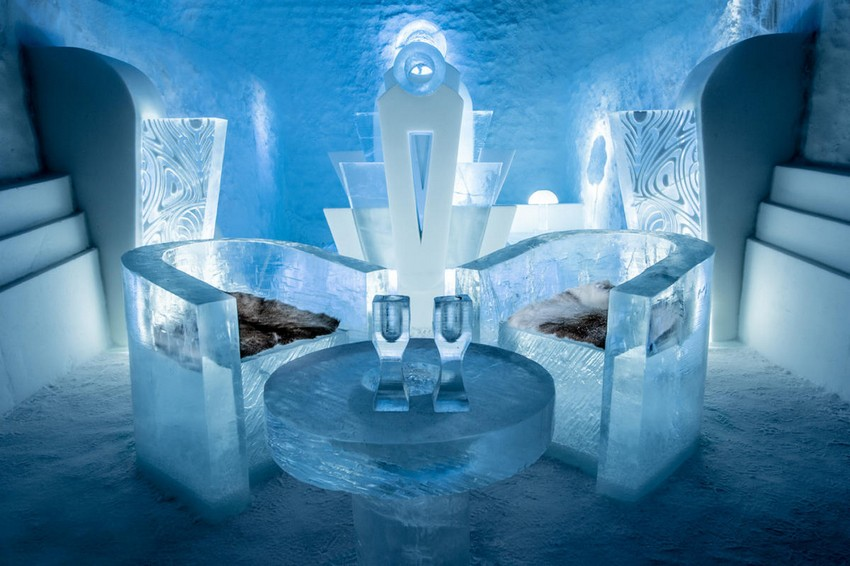 6-icehotel-sweden-cold-ice-room-interior-design-once-upon-a-time-art-deco-style-ice-acrved-arm-chairs-hand-carved-ice-figures