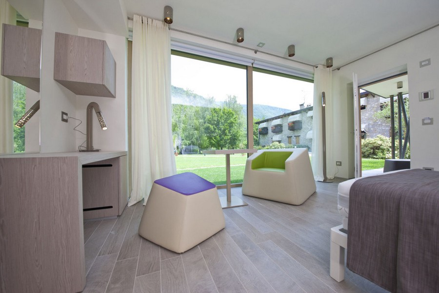 6-modern-minimalist-architecture-interior-design-solar-eco-house-Italy-Green-Zero-Daniele-Menichini-bedroom-geometrical-furniture-purple-green-gray-white-light-wood-floor-work-desk-panoramic-windows