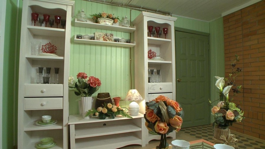 7-2-Provence-style-living-room-interior-design-green-mint-and-coral-colors-wooden-walls-white-shelf-unit-brick-wall-green-door
