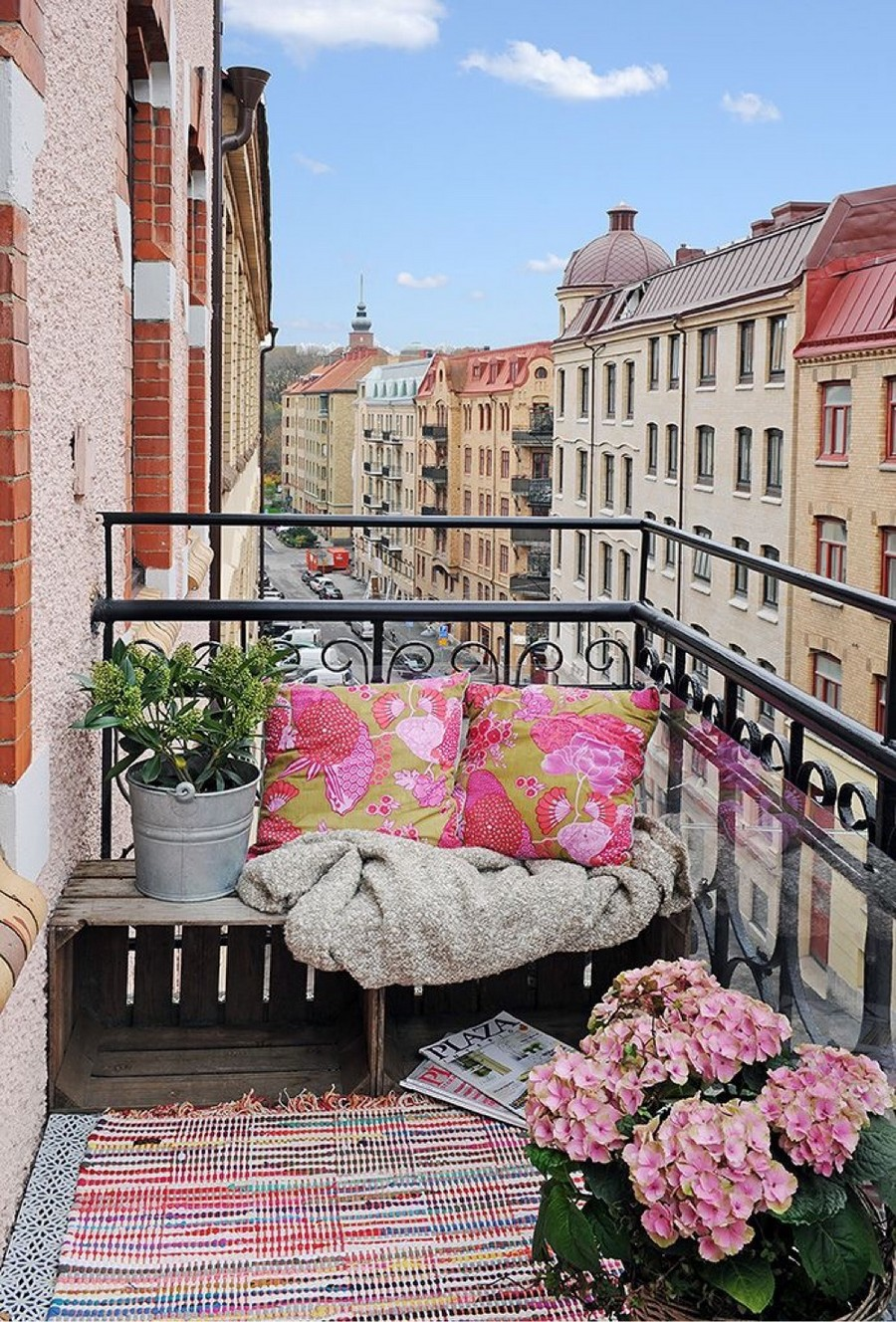7-modern-French-apartment-interior-design-France-beautiful-balcony-cozy-bench-sitting-spot-flowers-blankets-pillows-Paris