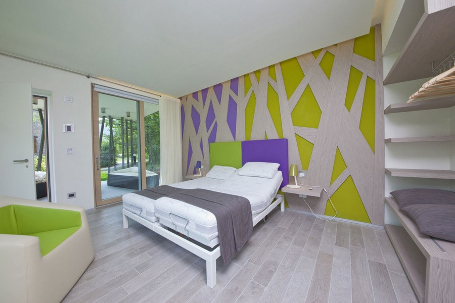 7-modern-minimalist-architecture-interior-design-solar-eco-house-Italy-Green-Zero-Daniele-Menichini-geometrical-furniture-3D-wall-decor-light-wood-naturalistic-colors-purple-green-bedroom-panoramic-windows-bed