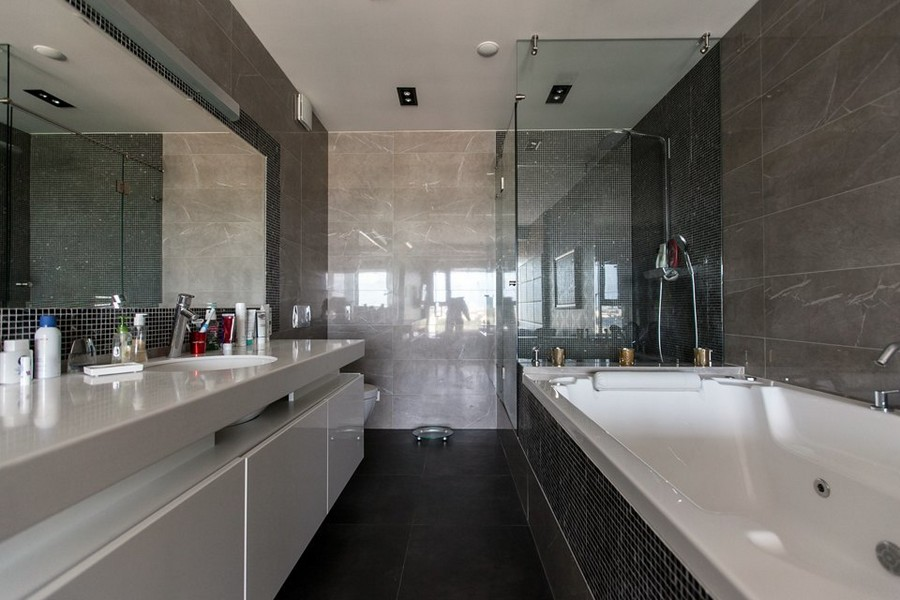 8-2-bachelor's-minimalist-bathroom-interior-design-glass-wall-partition-gray-and-beige-tiles-bathtub-shower-cabin-mosaic-suspended-wah-basin-cabinet