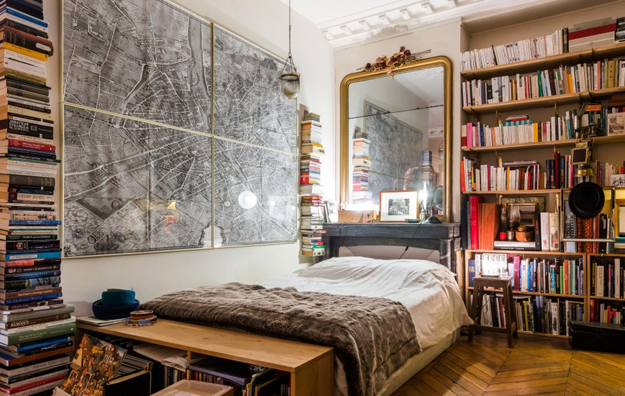 8-modern-French-apartment-interior-design-France-bedroom-mirror-many-books-piles-shelves_cr