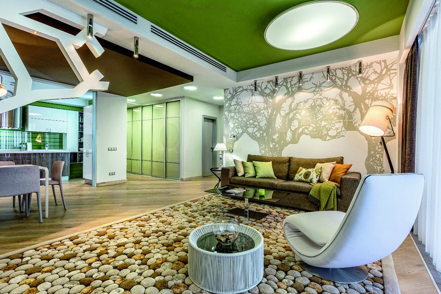 0-contemporary-style-open-concept-living-dining-room-lounge-kitchen-interior-design-plasterboard-sheetrock-3D-wall-decor-green-ceiling-brown-sofa-white-wall-mural-fitting-wool-handmade-carpet-pebbles
