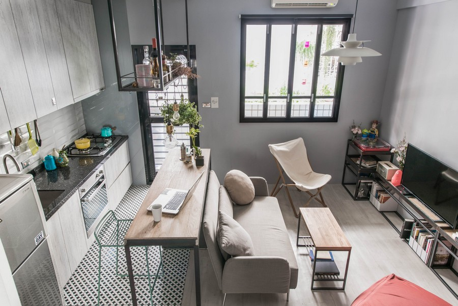 0-tiny-small-single-woman's-studio-apartment-Taiwan-gray-walls-floor-black-interior-design-accents-light-wood-kitchen-cabinets-living-room-lounge-zone-work-area-island-sofa-TV-table-chairs-high-ceiling