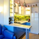 1-1-beautiful-creative-kitchen-backsplash-ideas-digital-photo-printing-greenery-summer-mood-blue-cabinets-sofa-bar-table-refrigerator-pendant-lamps-square-tiles-interior-design