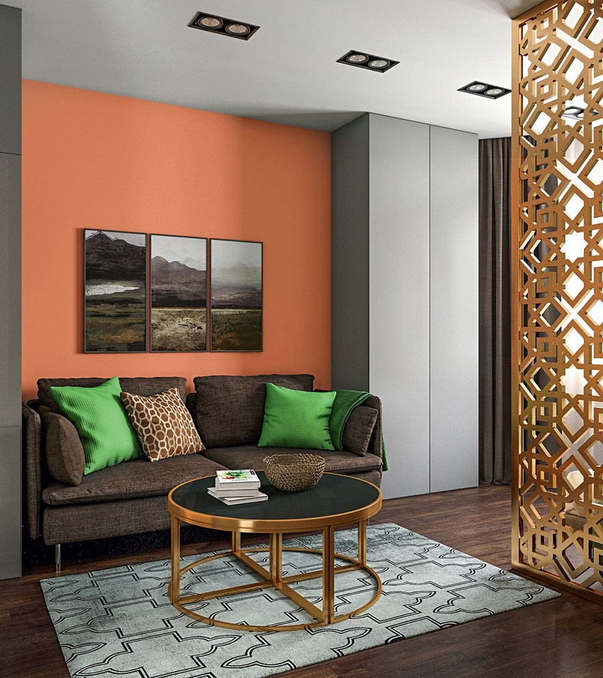 1-1-contemporary-style-interior-design-living-room-lounge-perforated-screen-room-divider-round-metal-coffee-table-Eichholtz-chocolate-brown-parquetry-IKEA-sofa-green-throw-pillows-orange-wall-geometrical-carpet