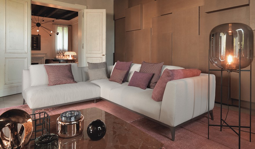 1-eclectic-style-contemporary-living-room-interior-with-art-deco-motifs-rose-gold-lamp-rug-pink-pillows-sofa-3D-wall-aged-vintage-white-doors-stone-coffee-table
