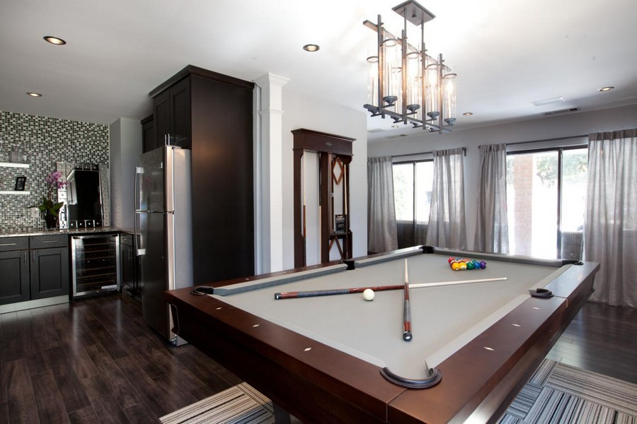 1-open-concept-kitchen-living-billiard-pool-room-interior-design-dark-wood-brown-gray-walls-bed-cloth-table-cues-contemporary-style